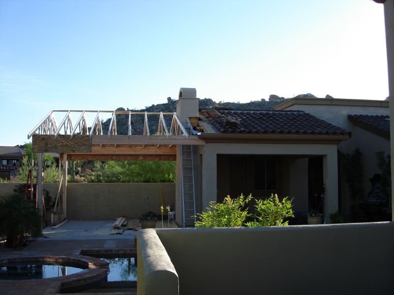 Framing in the roof of this outdoor kitchen to match the look with the rest of the house.