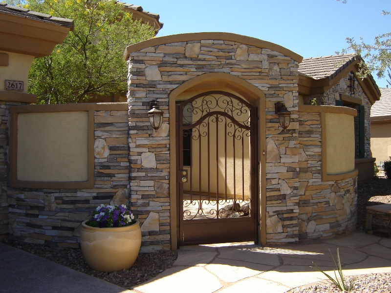 Gorgeous stone work makes the front entry courtyard at this Glendale AZ home something splendid indeed.