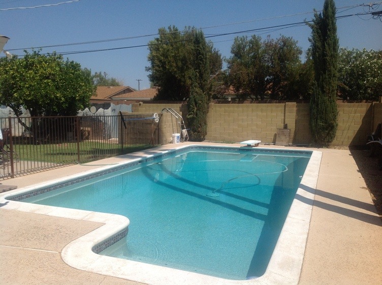 Nice pool, but outdated deck? Checkout pool remodeling - Scottsdale by Desert Crest LLC.