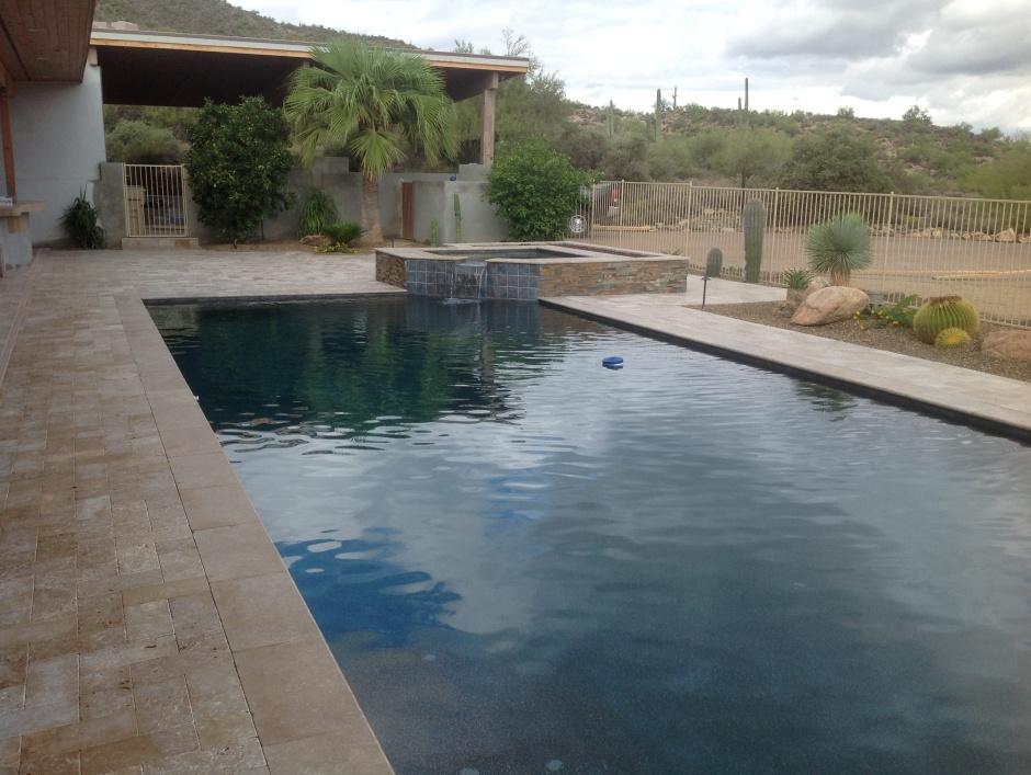 Travertine pool pavers, landscaping and Scottsdale pool installation by Desert Crest LLC.