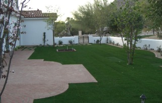 Lush, green sweeps of Phoenix - Scottsdale, Arizona lawns add huge assets and aesthetic value to any home.