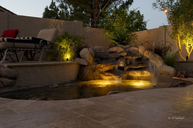 Night lighting transforms this Glendale landscaping waterfall pond into something spectacular.